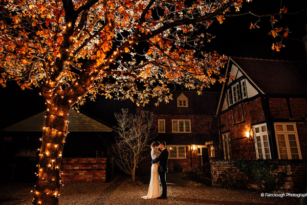 A couple take a moment in the evening at Curradine Barns wedding venue in Worcestershire | CHWV
