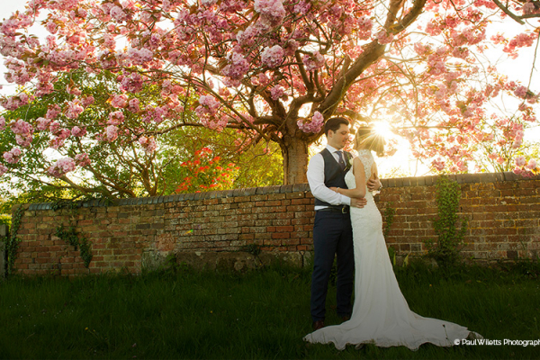 A happy couple in the grounds at Curradine Barns
