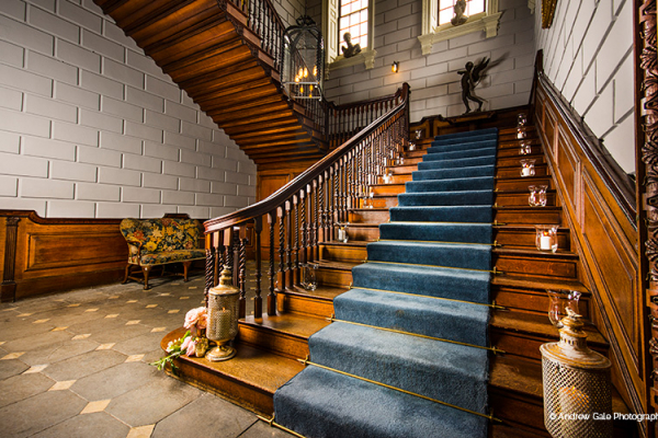 Wow guests with your entrance down the grand staircase at Davenport House wedding venue