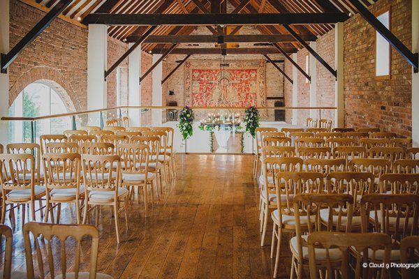 Set up for a ceremony at Delbury Hall wedding venue in Shropshire | CHWV