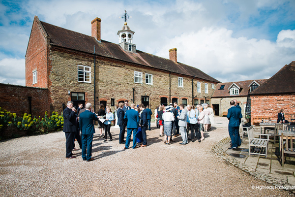 An outdoor drinks reception at Delbury Hall wedding venue in Shropshire | CHWV