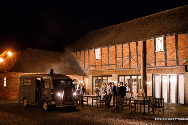 A pizza van in the evening at Delbury Hall wedding venue in Shropshire | CHWV