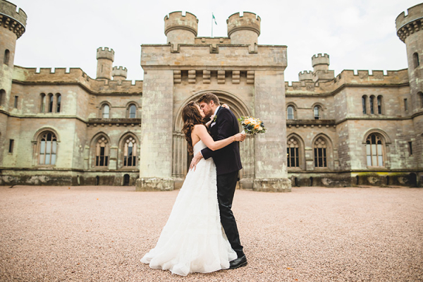 A happy couple taking a moment at Eastnor Castle wedding venue in Herefordshire | CHWV