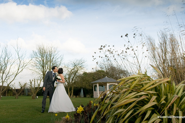 A happy couple in the grounds at Fennes