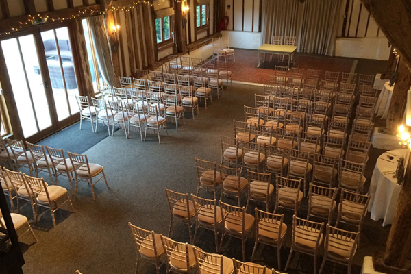 Fitzleroi Barn in West Sussex set up for a wedding ceremony | CHWV