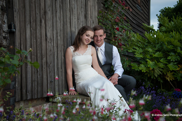 A happy couple in the beautiful grounds at Fitzleroi Barn in West Sussex | CHWV