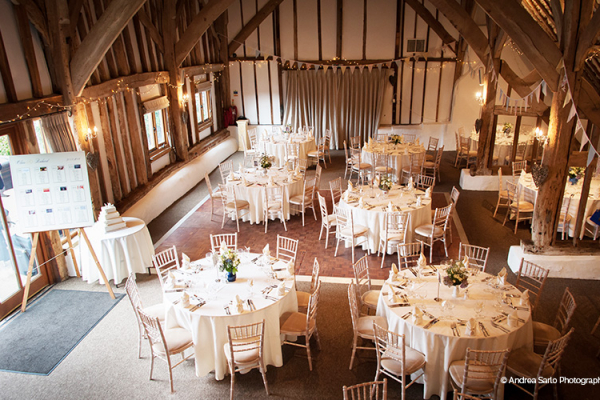 Set up for a wedding breakfast at Fitzleroi Barn wedding venue in West Sussex | CHWV