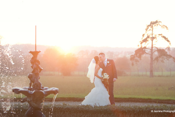Newlywed couple in the grounds at Gosfield Hall