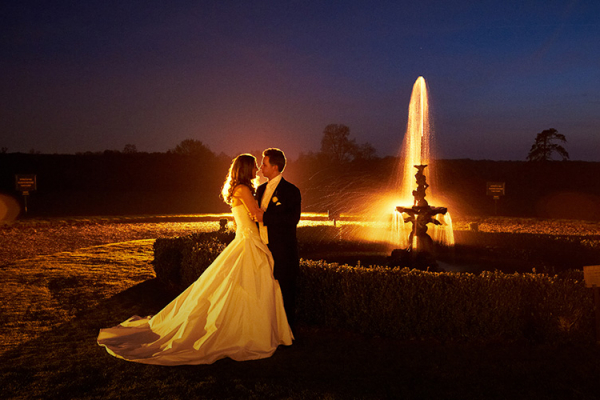 Newlywed couple at the fountain at Gosfield Hall