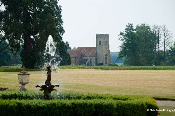 The grounds and fountain with Gosfield Hall in the background