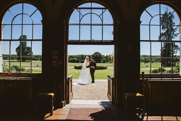 A happy couple taking a moment at Gosfield Hall wedding venue in Essex | CHWV