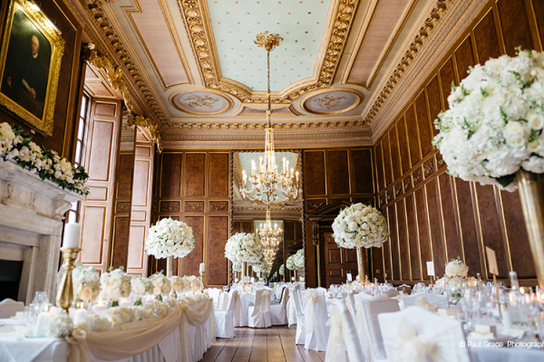 Tall floral table centrepieces at Gosfield Hall wedding venue in Essex | CHWV