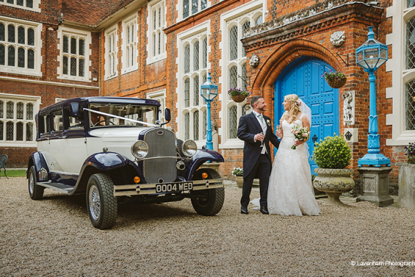 A happy couple in the courtyard at Gosfield Hall wedding venue in Essex | CHWV