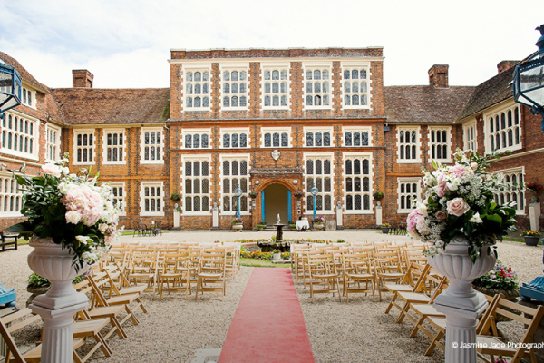 Set up for an outdoor wedding ceremony at Gosfield Hall wedding venue in Essex | CHWV