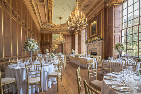 Set up for a wedding breakfast in the Ballroom at Gosfield Hall wedding venue in Essex | CHWV