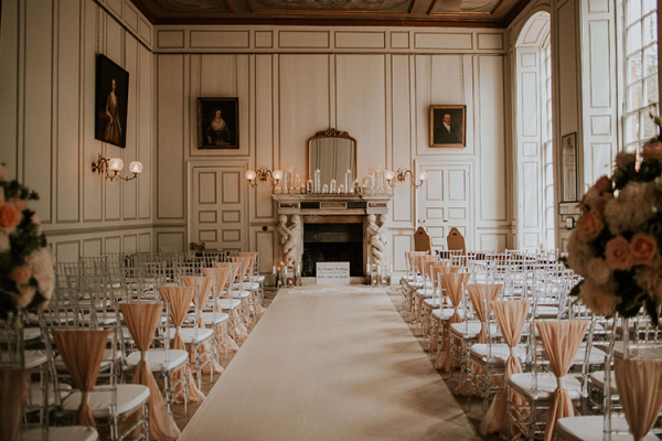 Set up for a wedding ceremony in the Grand Salon at Gosfield Hall wedding venue in Essex | CHWV