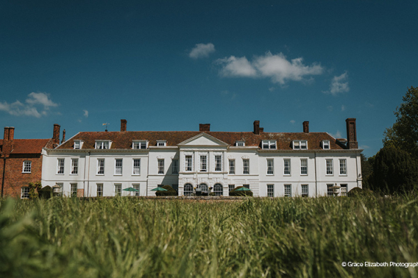 The front of the hall at Gosfield Hall wedding venue in Essex | CHWV