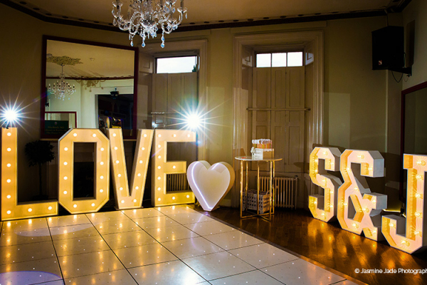 The dancefloor set up with LOVE letters at Gosfield Hall wedding venue in Essex | CHWV
