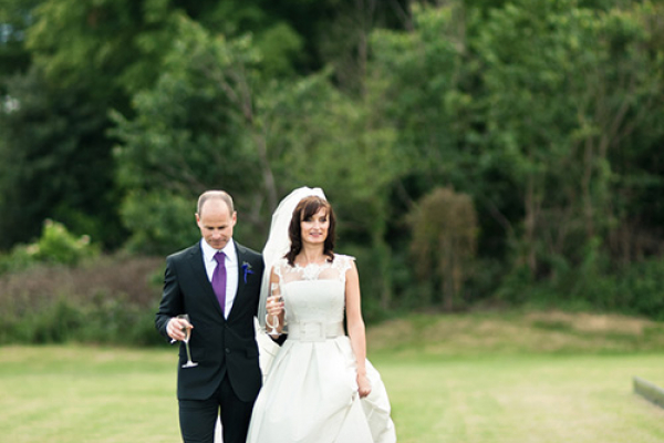 Newlywed couple in the grounds at Ham Polo Club