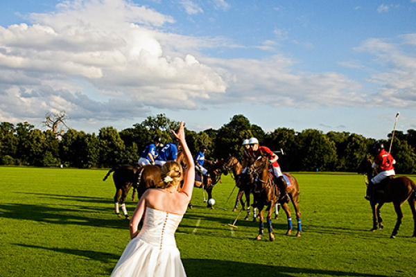 A bride cheering on the teams at Ham Polo Club