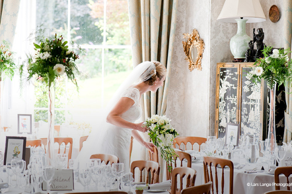 The Bride admiring the table decorations at Homme House - Country House Wedding Venue in Herefordshire