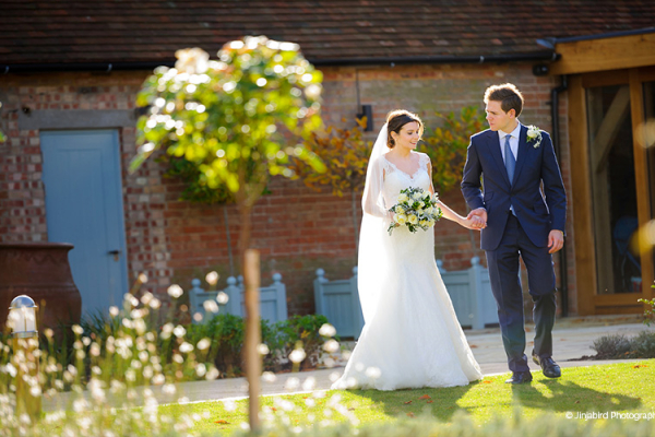 Wedding-couple-having-photos-outside-at-Bassmead-Manor-Barns