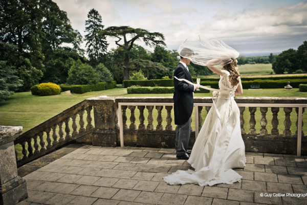Couple on the garden terrace at Kirtlington Park - Country House Wedding Venue in Oxfordshire