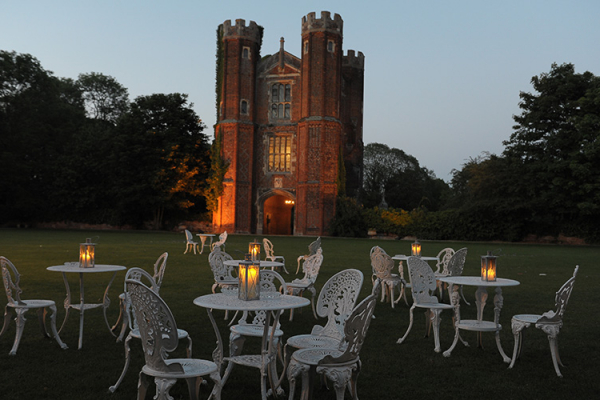 Candlelit tables on the manicured lawn at Leez Priory - Country House Wedding Venue in Essex