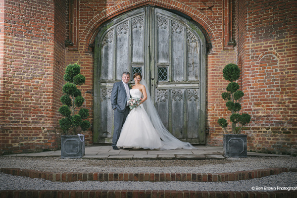 Bride and Groom in front of Leez Priory - Country House Wedding Venue in Essex