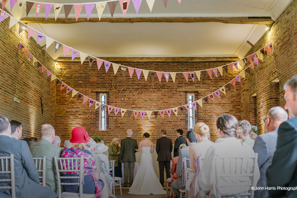 A wedding ceremony at Manor Mews - Barn Wedding Venue in Norfolk