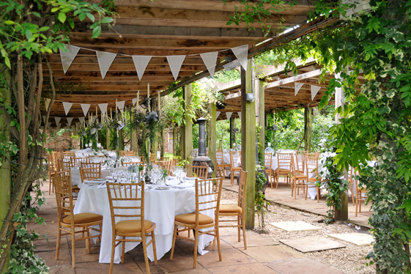 Alfresco dining in the gardens at Maunsel House - Country House Wedding Venue in Somerset