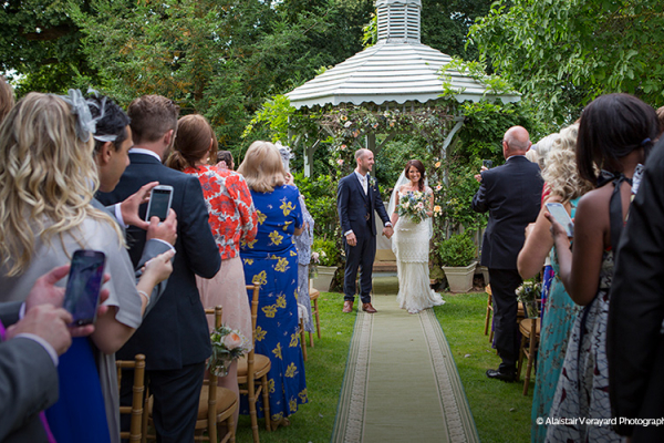 Just married in the walled garden at Maunsel House - Country House Wedding Venue in Somerset