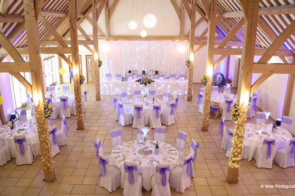 The Dining Barn dressed with a striking purple wedding theme.