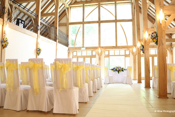 The Ceremony Barn chairs feature wedding chair covers and yellow ribbon - perfect for a spring wedding.