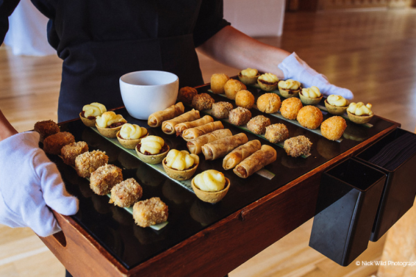 Close up of wedding canapes including delicious risotto balls and mini shepherd's pie - winter wedding food.