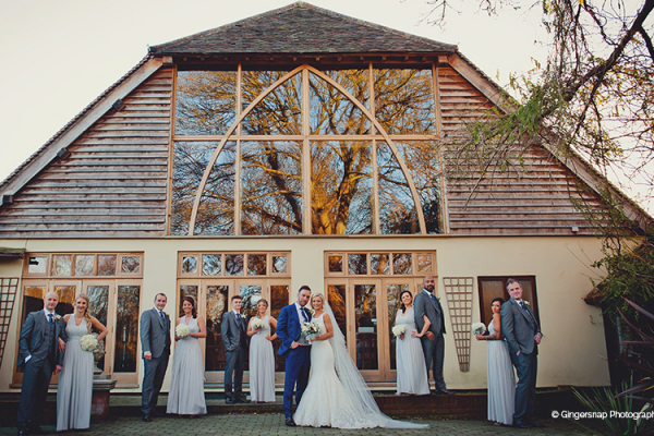 The wedding couple bridesmaids and groomsmen have their photo taken outside this ceremony wedding venue in Hampshire.