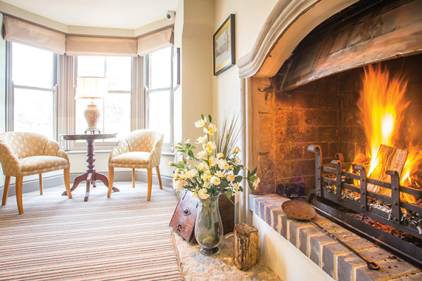 Fireplace at Southdowns Manor | West Sussex wedding venues