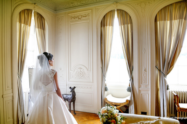 A bride in the Empire Room at Addington Palace in Surrey | CHWV