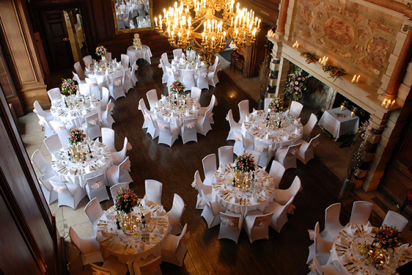 The Great Hall set up for a wedding breakfast Addington Palace wedding venue in Surrey | CHWV