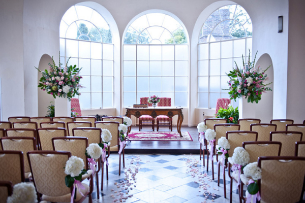 The Winter Garden set up for a wedding ceremony Addington Palace wedding venue in Surrey | CHWV