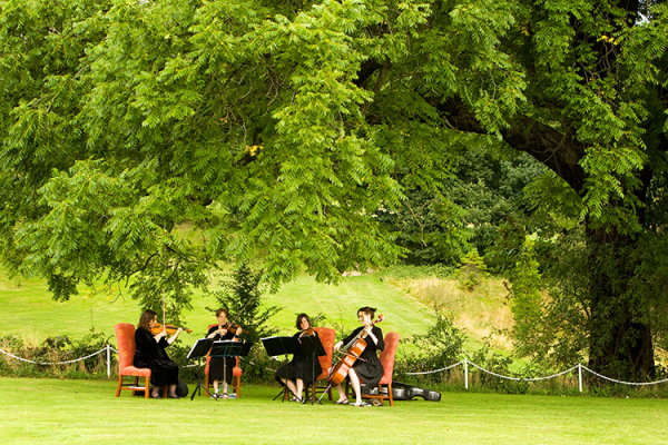 Music is played in the beautiful grounds at Addington Palace wedding venue in Surrey | CHWV
