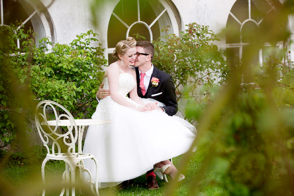 A happy couple take a moment in the beautiful grounds at Addington Palace wedding venue in Surrey | CHWV