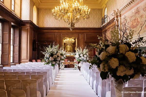 Set up for a wedding ceremony in The Royal Corridor at Addington Palace wedding venue in Surrey | CHWV