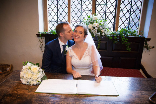 Signing the register at Anne of Cleves House wedding venue in East Sussex | CHWV