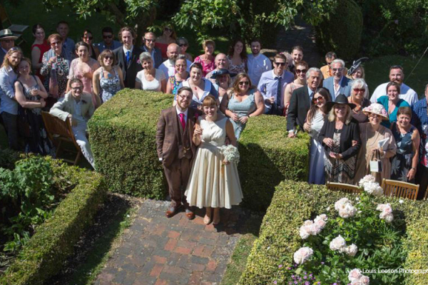 Group pose in the beautiful gardens at Anne of Cleves House wedding venue in East Sussex | CHWV