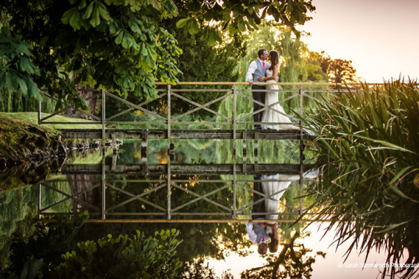 A couple taking a moment on the bridge at Ardington House wedding venue in Oxfordshire | CHWV