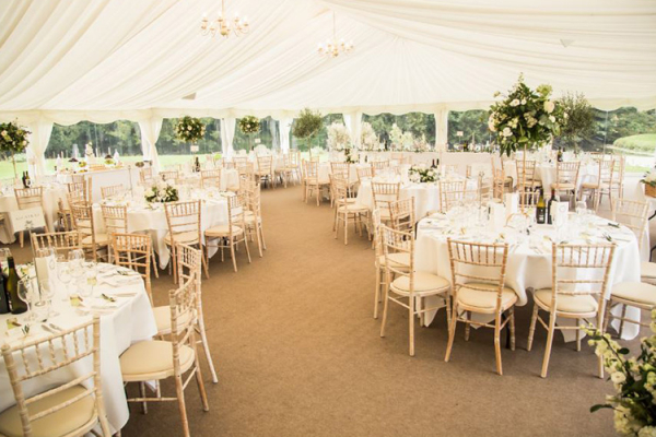 The marquee set up for a wedding breakfast at Ardington House wedding venue in Oxfordshire | CHWV