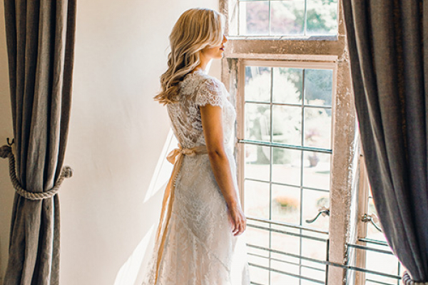 A bride getting ready at Askham Hall country house wedding venue in Cumbria | CHWV