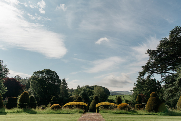 A view of the topiary in the gardens at Askham Hall wedding venue in Cumbria | CHWV
