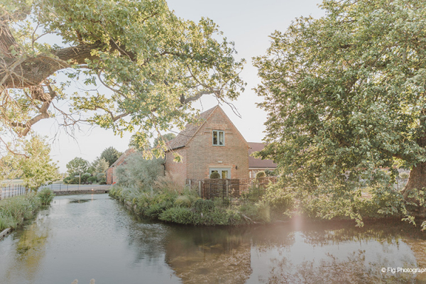 The moat surrounding Bassmead Manor Barns wedding venue in Cambridgeshire | CHWV